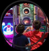 Kids playing arcade games.