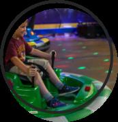 Child riding the bumper cars.
